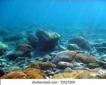 Underwater light on a rocky seafloor in the Mediterranean sea