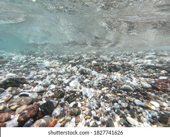 Underwater photo of beautiful pebble beach of Krovoulia near picturesque village of Frikes, Ithaki island, Ionian, Greece