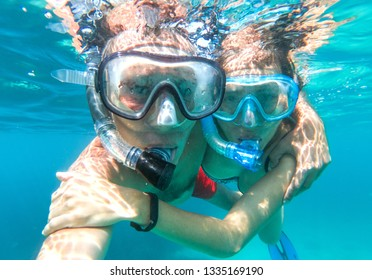 Underwater photo of a couple snorkeling in tropical sea