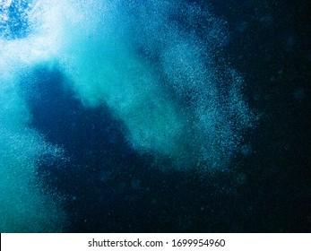 Underwater photography of  splashing bubble.