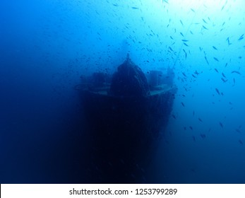 Underwater photography of sunken ship wreck is lay under Gulf of Thailand sea as artificial reef. It look mysterious and frightening.