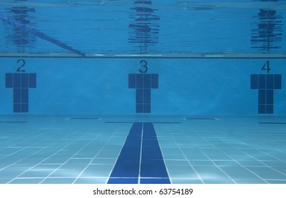 Underwater picture of the lanes 2, 3 and 4 of a swimming pool; sport concept.