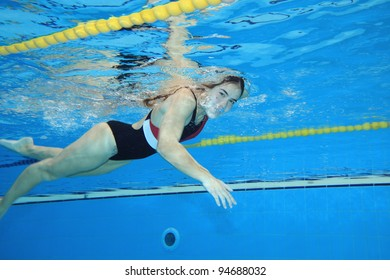 Underwater picture of a young woman swimming.