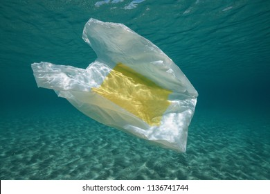 Underwater a plastic bag below water surface in the Mediterranean sea , Almeria, Andalusia, Spain