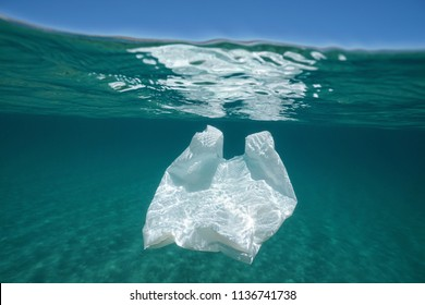 Underwater pollution a plastic bag adrift in the Mediterranean sea below water surface, Almeria, Andalusia, Spain