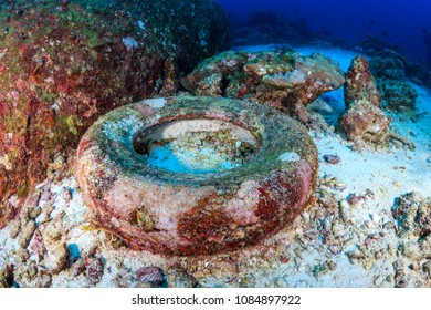 Underwater pollution - rubber tires pollute the seabed of a tropical coral reef