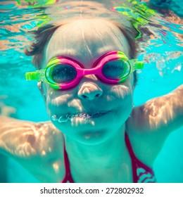 Underwater portrait of happy child. Summer vacation