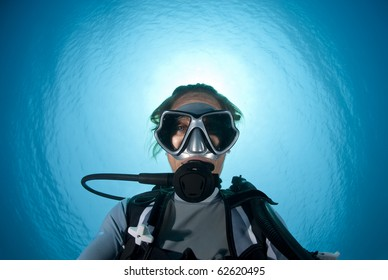 Underwater portrait of a woman scuba diving.  Shaab Ohrob, Southern Red Sea, Egypt.