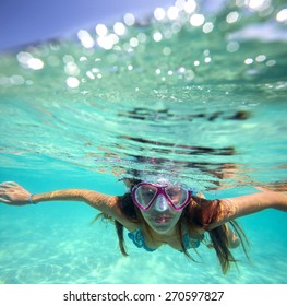 Underwater Portrait of a Yong Woman Snorkeling in Ocean.