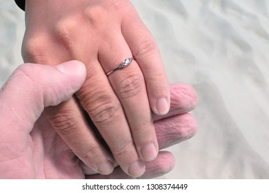 Underwater proposal. Two hands and the diamond engagement ring. Valentine's Day moment. Paradise holidays in the tropics. Couple in love.