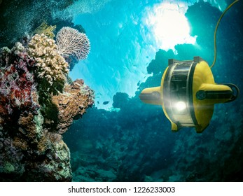 Underwater robot explores the deep sea - This image is an illustration