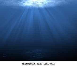 An underwater scene with sun rays shining through the water (dark bottom)