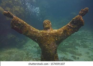 Underwater Sculpture of Praying Jesus