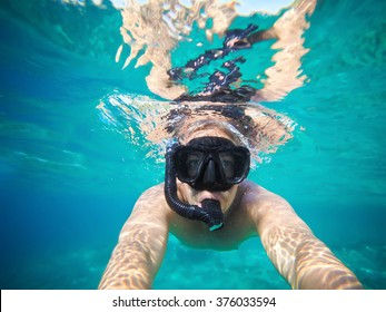 Underwater selfie shot. Snorkeling just below the surface.