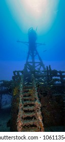 Underwater shipwrecks crows nest with a ladder in the foreground and a blue water background in Key Largo, Florida. The Coast Guard Cutter Duane in John Pennekamp State Park.