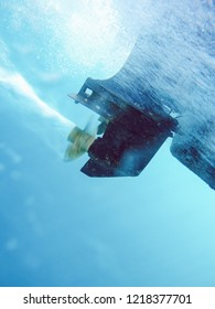 Underwater shot of running outboard motor