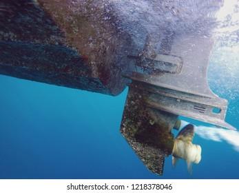 Underwater shot of running ship propeller