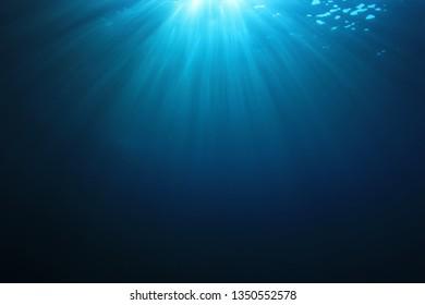 Underwater sunburst in blue ocean