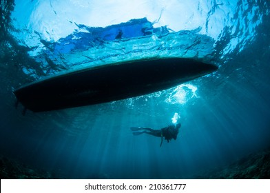 Underwater sunshine below the boat in Gorontalo, Indonesia. There's a boat at surface, so the sun shine through the boat.