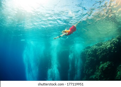 underwater swimming with corals