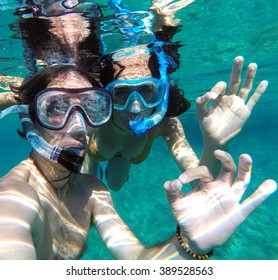 Underwater view of a snorkeling couple