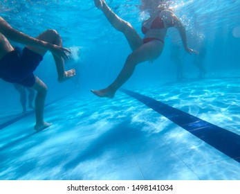 Underwater view from a women diving in a pool