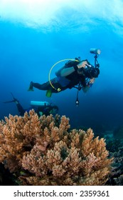 Underwater-photographer in action above reef. Indonesia Sulawesi