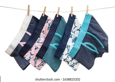 Underwear clothes (underpants) for toddler boy hanging on the clothesline isolated on a white background