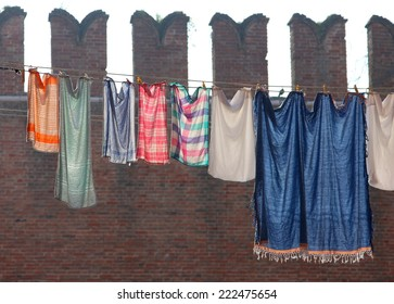Underwear drying on a background of ancient  fortress wall of Arsenal, Venice, Ital