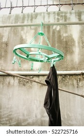 Underwear on a clothesline outside the house