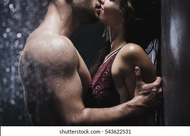 Undressed couple kissing passionately in the shower