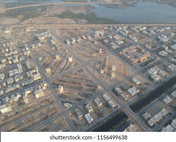 unedited drone photo of the daimond streets shoing streets the make a shape like a daimond and showing buildings land water and greenry and the beauty of karachi