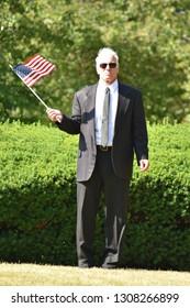 Unemotional Adult Senior Congressman Wearing Suit And Tie Walking