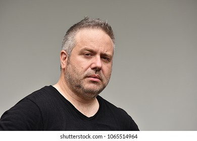 Unemotional Caucasian Man