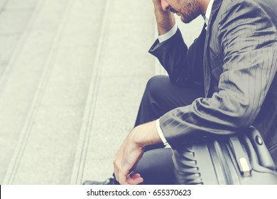 Unemployed businessman stress sitting on stair, concept of business failure and unemployment problem, work life balance, image processing instagram vintage color.