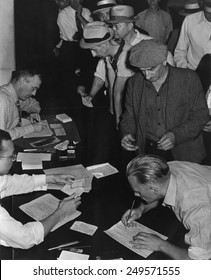 Unemployed men filling out Social Security benefit claims, ca. 1938. In January 1938, new Social Security programs made unemployment compensation available.