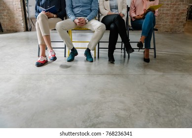 Unemployed people in the waiting room job hunting
