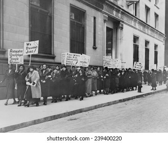 "Unemployed single women in New York demonstrate for public works jobs. Some placards read ""Forgotten women,"" because public policy focused only on men's unemployment. December 7 , 1933"