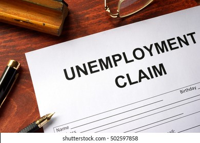 Unemployment claim form on an office table.