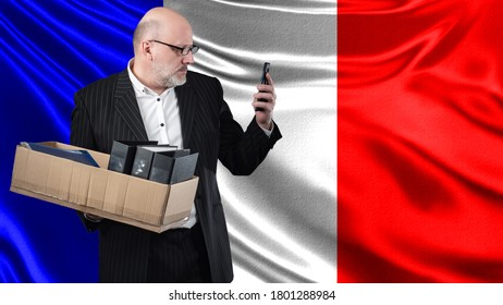 Unemployment in France. Man with a cardboard box a symbol of unemployment. Crisis of labor market in France. Frenchman lost job. Adult man holds a box with personal belongings. Man in search of work