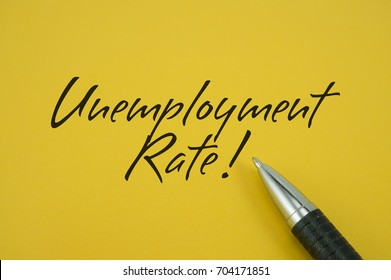 Unemployment Rate! note with pen on yellow background