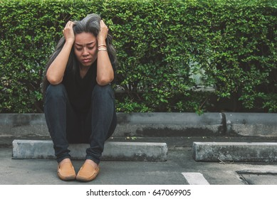 Unemployment woman and gray hair with worried stressed face expression looking down with copy space, vintage tone