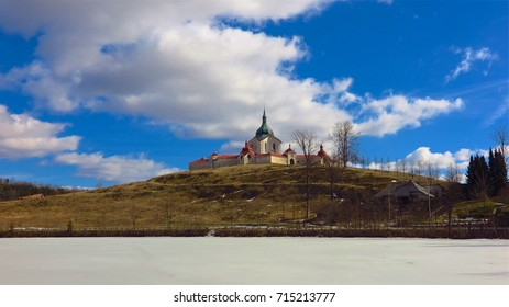 UNESCO Pilgrimage Church of St John of Nepomuk in Zdar nad Sazavou, Czech Republic across frozen lake