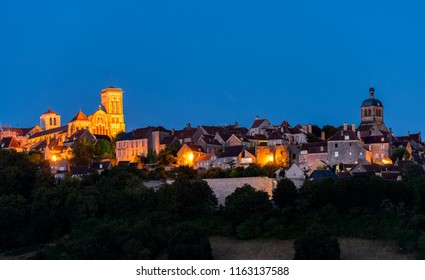 The UNESCO village of Vezelay on a hill with the Benedictine abbey and church of Saint Mary Magdalene at night in Yonne, France.