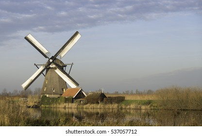 UNESCO World Heritage windmills in Kinderdijk in Holland europe, windmills at the water with reflection and twilight
