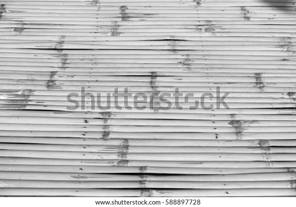 Uneven black and white bamboo background