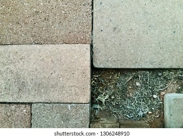 Unevenly placed outdoor patio paver stones and bricks on ground. Textural asymmetry, copy space background conceptual suitable for home diy, construction, building, business concepts