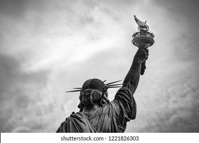 An unexpected view of the world famous Statue of Liberty in New York City. Captured in black & white against a dramatic sky.