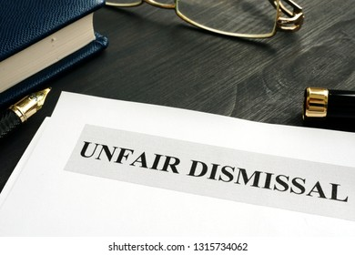Unfair dismissal documents and pen in an office.