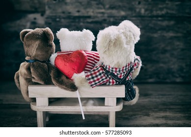 Unfaithful, doll bear man holding hands with guy and give love Heart behind back bear girl.